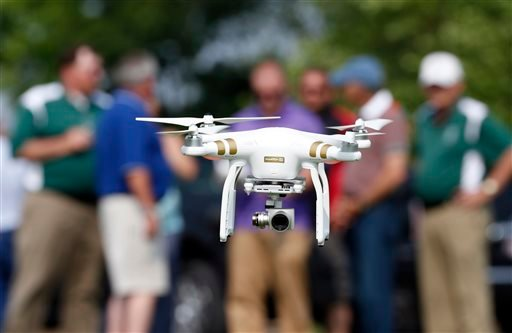 In this June 11, 2015, photo, a DJI Phantom 3 drone is flown by Matthew Creger, marketing director for Intelligent UAS, during a drone demonstration at a farm and winery on potential use for board members of the National Corn Growers in Cordova, Md. The s