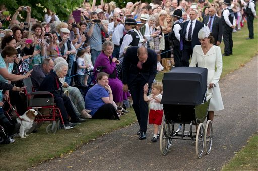 Britain's Prince William, Kate the Duchess of Cambridge, their son Prince George and daughter Princess Charlotte in a pram arrive for Charlotte's Christening at St. Mary Magdalene Church in Sandringham, England, Sunday, July 5, 2015. (AP Photo/Matt Dunham