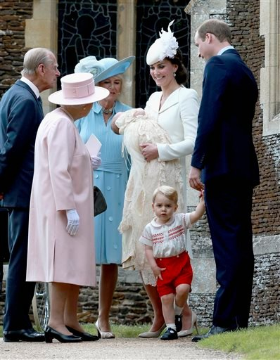 Kate, the Duchess of Cambridge, centre, right, holding their daughter Princess Charlotte of Cambridge stands next to Britain's Prince William, Duke of Cambridge, holding their son Prince George of Cambridge's hand, as they talk to Britain's Queen Elizabet