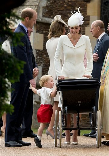 Britain's Prince George gets up on tip-toes to peek into the pram of Prince Charlotte watched by his parents Prince William and Kate the Duchess of Cambridge as they leave after Charlotte's Christening at St. Mary Magdalene Church in Sandringham, England,