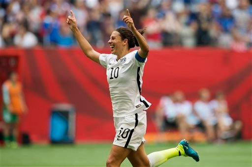 United States' Carli Lloyd (10) celebrates her third goal against Japan during first half action in the FIFA Women's World Cup soccer championship in Vancouver, British Columbia, Canada, Sunday, July 5, 2015. (Jonathan Hayward/The Canadian Press via AP)