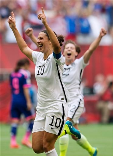 United States' Carli Lloyd (10) and Meghan Klingenberg (22) celebrate Lloyd's third goal against Japan during first half action in the FIFA Women's World Cup soccer championship in Vancouver, British Columbia, Canada, Sunday, July 5, 2015. (Jonathan Haywa