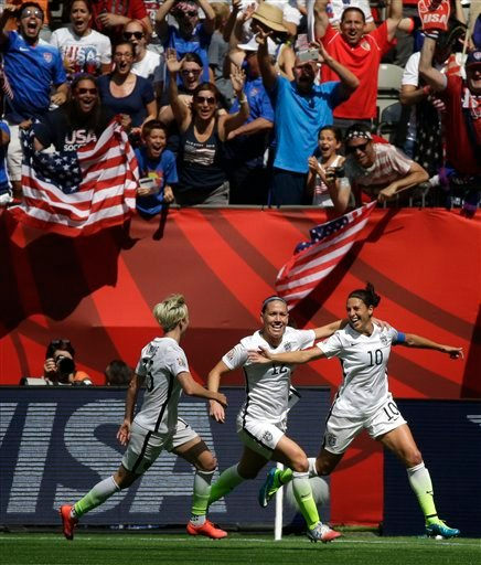 From left, United States' Megan Rapinoe, Lauren Holiday, and Carli Lloyd celebrate after Lloyd scored her second goal of the match against Japan during the first half of the FIFA Women's World Cup soccer championship in Vancouver, British Columbia, Canada