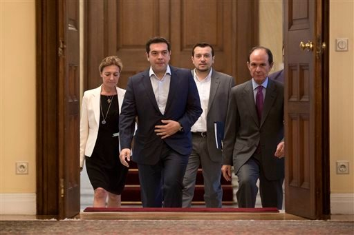"Greek Prime Minister Alexis Tsipras, second from right, arrives for a Greek political leaders meeting in Athens, on Monday, July 6, 2015. Finance Minister Yanis Varoufakis has resigned following Sunday's referendum in which the majority of voters said ""no"
