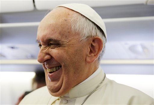 Pope Francis laughs as he meets the journalists aboard the papal airplane on the occasion of his visit to Quito, Ecuador, July 5, 2015. The Pontiff is visiting Ecuador, Bolivia and Paraguay during his Apostolic trip from July 5 to July 12. (AP Photo/Grego