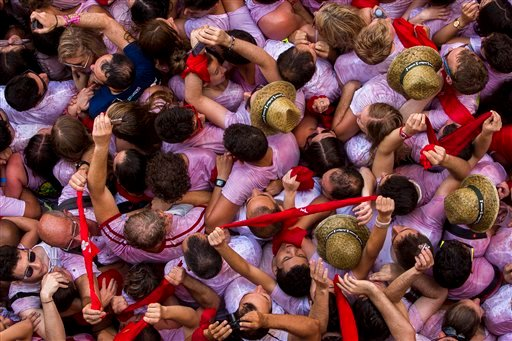 """Revelers pack the Pamplona town square during the launch of the """"Chupinazo"""" rocket, to celebrate the official opening of the 2015 San Fermin fiestas in Pamplona, Spain, Monday, July 6, 2015. Revelers from around the world turned out here to kick off the f"""