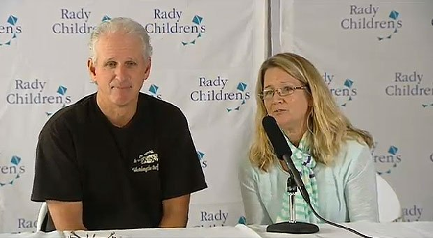 The parents of Nicholas Baer, the boy hit by a plane at a Carlsbad beach, talk to media at a press conference.