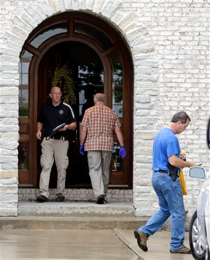 Federal authorities walk outside of the home of Subway restaurant spokesman Jared Fogle, Tuesday, July 7, 2015, in Zionsville, Ind.