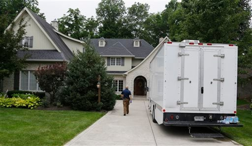 Federal authorities walk into the home of Subway restaurant spokesman Jared Fogle, Tuesday, July 7, 2015, in Zionsville, Ind.