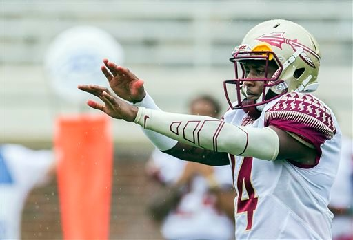his photo taken April 11, 2015, shows Florida State quarterback De'Andre Johnson calling a play in the first half of Florida State Garnet & Gold spring college football game in Tallahassee, Fla.