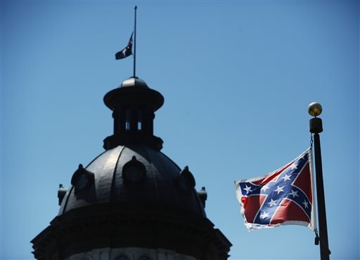 In this June 19, 2015 file photo, the Confederate flag flies near the South Carolina Statehouse in Columbia, S.C.