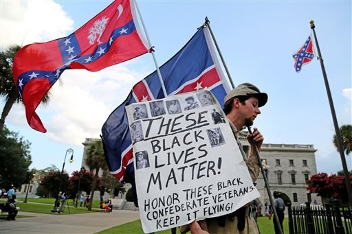 Josh Clarke, of Shelby, N.C., voices his side of the Confederate flag issue in front of the Statehouse, Monday, July 6, 2015, in Columbia, S.C.