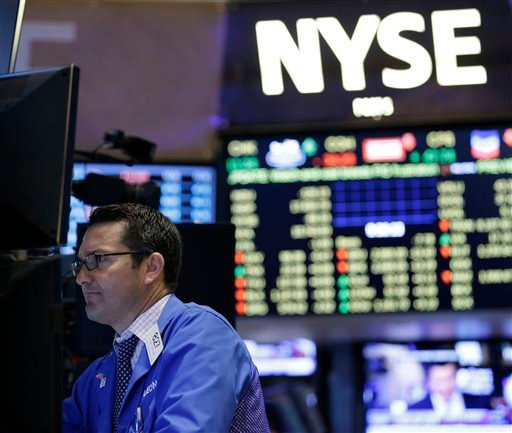 Traders work on the floor at the New York Stock Exchange in New York, Wednesday, July 8, 2015.