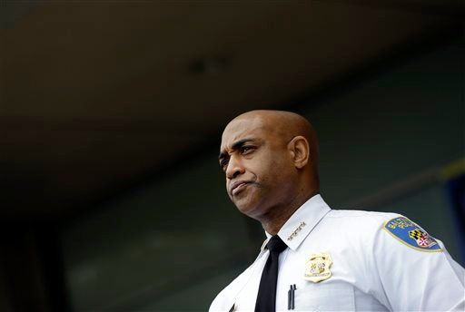 In this April 30, 2015, file photo, Baltimore Police Department Commissioner Anthony Batts listens as Deputy Commissioner Kevin Davis speaks at a news conference, in Baltimore. Baltimore Mayor Stephanie Rawlings-Blake announced the firing of Batts in a ne