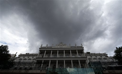 Dark clouds hang over Palais Coburg where closed-door nuclear talks with Iran take place in Vienna, Austria, Thursday, July 9, 2015. (AP Photo/Ronald Zak)