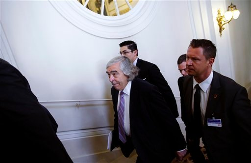 U.S. Secretary of Energy Ernest Moniz, centre, arrives for a meeting at an hotel in Vienna, Thursday, July 9, 2015. Negotiations over Iran's nuclear program lurched toward another deadline on Thursday with diplomats reconvening amid persistent uncertainty