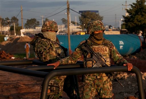 "Mexican navy marines patrol near the maximum security prison Altiplano in Almoloya, west of Mexico City, Sunday, July 12, 2015. Mexico's most powerful drug lord, Joaquin ""El Chapo"" Guzman, escaped from a maximum security prison through a tunnel that opene"