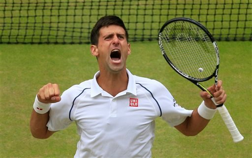 Novak Djokovic of Serbia celebrates winning the men's singles final against Roger Federer of Switzerland at the All England Lawn Tennis Championships in Wimbledon, London, Sunday July 12, 2015. Djokovic won the match 7-6, 6-7, 6-4, 6-3. (Jonathan Brady/Po