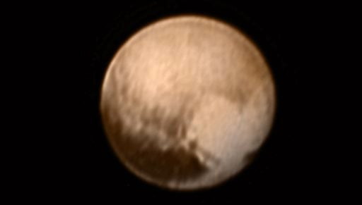This image received on July 8, 2015 and made available by NASA/Johns Hopkins University Applied Physics Laboratory/Southwest Research Institute shows Pluto from the New Horizons' Long Range Reconnaissance Imager (LORRI) combined with lower-resolution colo