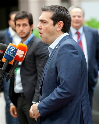 Greek Prime Minister Alexis Tsipras arrives for a meeting of eurozone heads of state at the EU Council building in Brussels on Sunday, July 12, 2015. Greece has another chance Sunday to convince skeptical European creditors that it can be trusted to enact