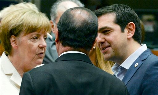 German Chancellor Angela Merkel, left, speaks with French President Francois Hollande, center, and Greek Prime Minister Alexis Tsipras during a meeting of eurozone heads of state at the EU Council building in Brussels on Sunday, July 12, 2015. Skeptical E