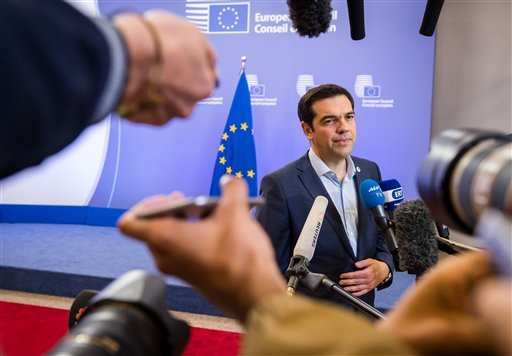Greek Prime Minister Alexis Tsipras speaks with the media after a meeting of eurozone heads of state at the EU Council building in Brussels on Monday, July 13, 2015. A summit of eurozone leaders reached a tentative agreement with Greece on Monday for a ba