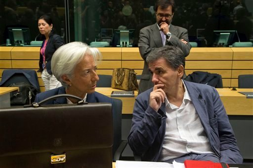Greek Finance Minister Euclid Tsakalotos, right, speaks with Managing Director of the International Monetary Fund Christine Lagarde during a round table meeting of eurogroup finance ministers at the EU Lex building in Brussels on Sunday, July 12, 2015. Gr