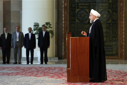 Iran's president Hassan Rouhani addresses the nation in a televised speech minutes after a landmark nuclear agreement was announced in Vienna, in Tehran, Iran, Tuesday, July 14, 2015.