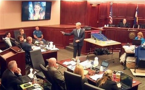 In this image taken from video, accused Colorado theater shooter James Holmes, background left. AP