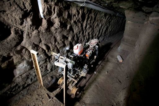 """A motorcycle adapted to a rail sits in the tunnel under the half-built house where according to authorities, drug lord Joaquin """"El Chapo"""" Guzman made his escape from the Altiplano maximum security prison in Almoloya, west of Mexico City."""