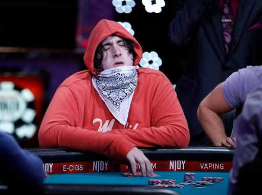 Justin Schwartz reacts after getting knocked out of the World Series of Poker main event Tuesday, July 14, 2015, in Las Vegas.