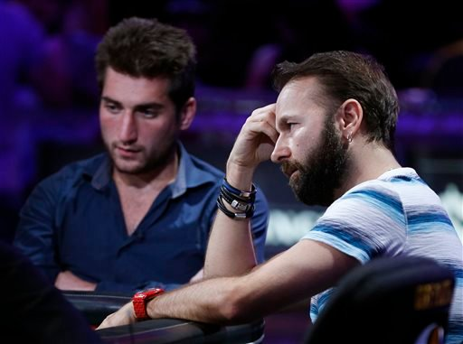 Daniel Negreanu, right, and Federico Butteroni compete at the World Series of Poker main event Tuesday, July 14, 2015, in Las Vegas.