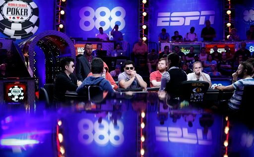 Players compete at the World Series of Poker main event Tuesday, July 14, 2015, in Las Vegas.