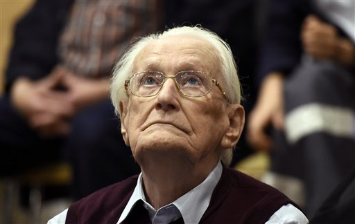 94-year-old former SS sergeant Oskar Groening looks up as he listens to the verdict of his trial Wednesday, July 15, 2015 at a court in Lueneburg, northern Germany. Groening, who served at the Auschwitz death camp was convicted on 300,000 counts of access