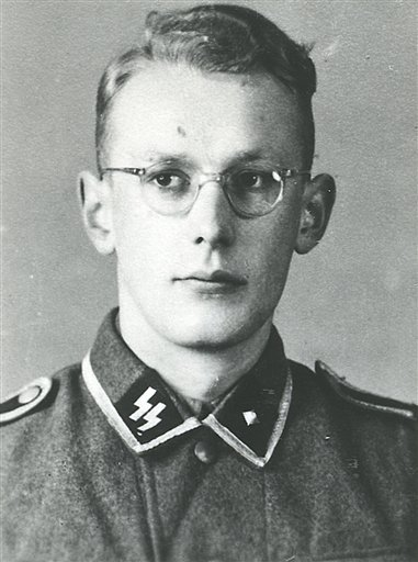 This undated photo made available by the Auschwitz-Birkenau State Museum, in Oswiecim, Poland, shows the former Auschwitz-Birkenau guard Oskar Groening as a young man in an SS uniform. Groening, 94, was convicted Wednesday by a Germany court on 300,000 co