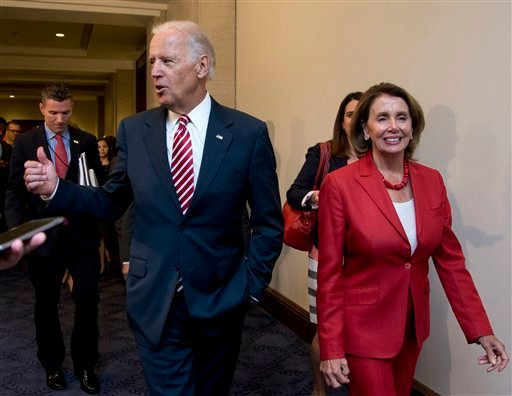 Vice President Joe Biden and House Minority Leader Nancy Pelosi of Calif., leave a meeting with the House Democratic Caucus about the Iran nuclear deal, Wednesday, July 15, 2015, on Capitol Hill in Washington. (AP Photo/Manuel Balce Ceneta)