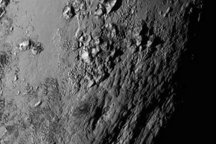NASA -  a region near Pluto's equator with a range of mountains captured by the New Horizons spacecraft.