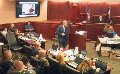 In this image taken from video, accused Colorado theater shooter James Holmes, on the upper far left, listens to defense attorney Daniel King give closing arguments during his trial, in Centennial, Colo., Tuesday, July 14, 2015. (Colorado Judicial Departm