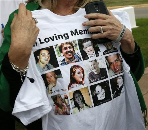 Sandy Phillips, whose daughter Jessica Ghawi was killed in the 2012 Aurora movie theatre massacre, carries a T-shirt memorializing the twelve people killed in the attack, outside the Arapahoe County District Court following the day of closing arguments in