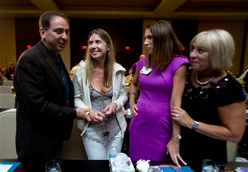 Tal Cohen, from left, and his wife Giedre Cohen, 37, of Calabasas, Calif., and Carrie Richardson, 34, and Mary Salter, of Montgomery, Ala., chat during a break at the Alzheimer's Association International Conference in Washington, Saturday, July 18, 2015.