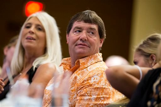 Dean DeMoe, center, with his wife, Deb DeMoe, left, and their daughter McKenna DeMoe, 19, right, attend the Alzheimer's Association International Conference in Washington, Saturday, July 18, 2015. Alzheimer's has ravaged generations of Dean DeMoe's family