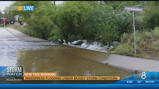 This is a video screen image that shows the San Diego River overflowing along Avenida Del Rio between Riverwalk Drive and Camino De La Reina. (Monday, July 20, 2015)