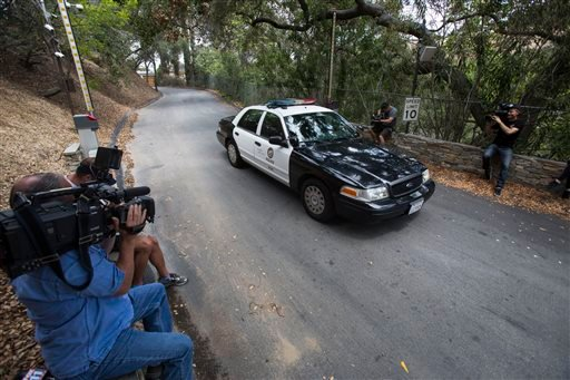 A police car leaves through a gate at a Beverly Hills, Calif. home owned by actress Demi Moore, Sunday, July 19, 2015. Coroner's officials say a 21-year-old man accidentally drowned in the backyard pool at the home. (AP Photo/Ringo H.W. Chiu)