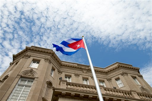 The Cuban flag is raised over their new embassy in Washington, Monday, July 20, 2015.