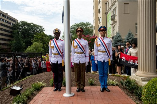 Members of the Cuban honor guard stand at attention following a ceremony to raise the Cuban flag over their new embassy in Washington, Monday, July 20, 2015.