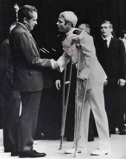 In this Sept. 14, 1973, file phot, John McCain is greeted by President Richard Nixon, left, in Washington. Republican presidential candidate Donald Trump criticized Sen. John McCain's military record at a conservative forum Saturday, saying the party's 20