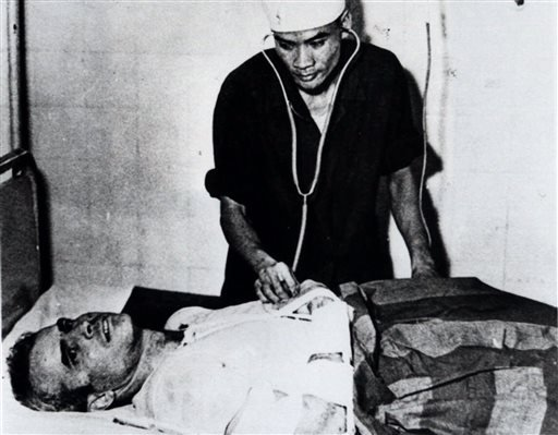 In this fall 1967 file photo, John McCain is administered to at a Hanoi, Vietnam hospital as a prisoner of war. Republican presidential candidate Donald Trump criticized Sen. John McCain's military record at a conservative forum Saturday, saying the party
