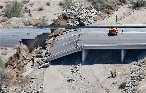 This aerial photo shows the collapsed elevated section of Interstate 10, Monday, July 20, 2015, in Desert Center, Calif. All traffic along one of the major highways connecting California and Arizona was blocked indefinitely when the bridge over a desert w