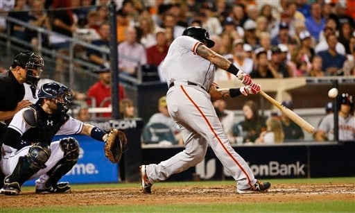 San Francisco Giants' Hector Sanchez swings on a grand slam against the San Diego Padres during the sixth inning of a baseball game Tuesday, July 21, 2015, in San Diego.
