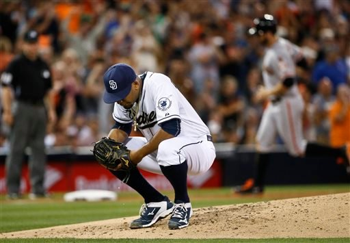 San Diego Padres starting pitcher Odrisamer Despaigne squats on the mound as San Francisco Giants' Brandon Crawford rounds the bases with a three-run home run during the fourth inning of a baseball game Tuesday, July 21, 2015, in San Diego.